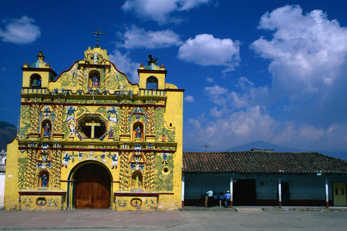 The bizarre, highly decorated bright yellow church of San Andres Xecul in Totonicapan.