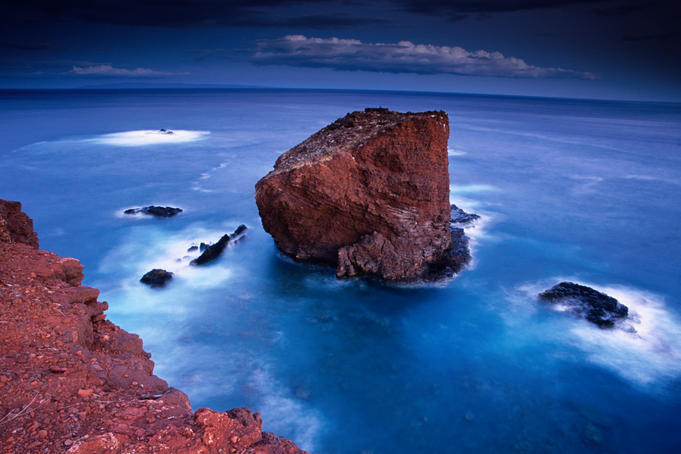 Puu Pehe (Sweetheart Rock) at dusk from atop the Pali Lei no Haunui (cliffs) at Manele Bay, Lanai.