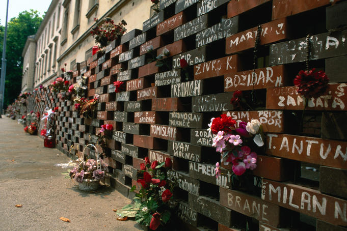 The memorial wall of bricks around the NATO building in Zagreb representing the lost and dead peple from the civil war.