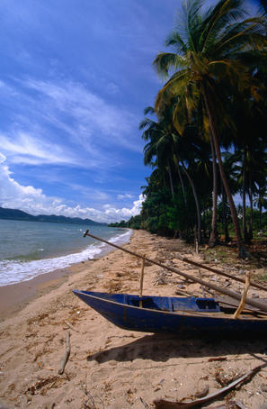 A fishing boat on one of the unspoilt beaches of Koh Tonsay in the Gulf of Thailand.