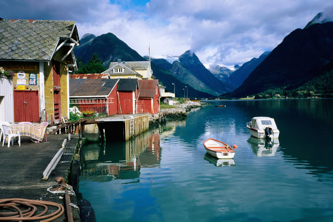Quayside buildings and boats on fjord.