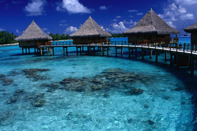Stilt bungalows over the waters of Rangiroa Lagoon.