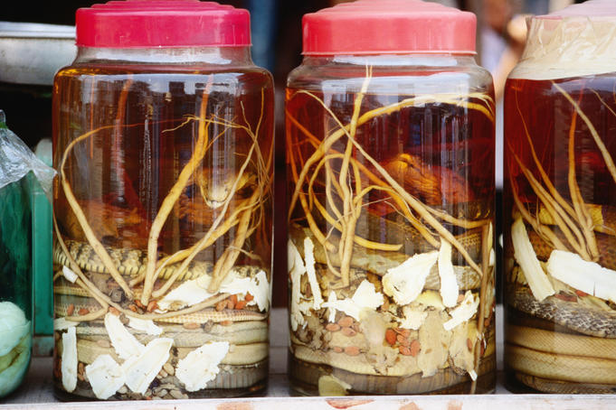 Snake wine for sale, a local delicay of the Mekong River delta area.