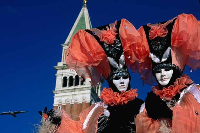 Costumed and masked carnival participants.
