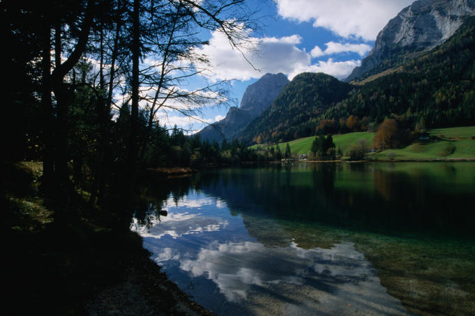 Clouds above, and reflected in, the still waters of Hintersee in the Bavarian Alps.