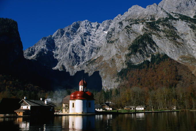 The onion-domed Saint Bartholoma chapel on the shores of Konigssee at the base of Mittelspitze (2713m) in the Bavarian Alps.