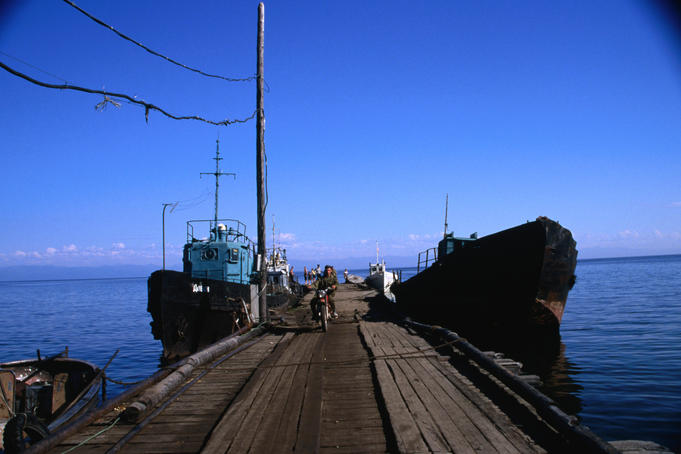 Ships docked alongside the wooden jetty in the picturesque village of Baikalskoe, North Lake Baikal.