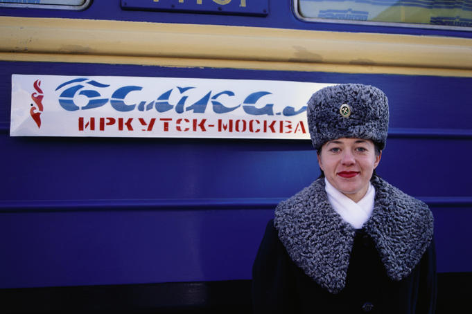 A Prodvodnista (carriage attendant) standing in front of No 9 and 10 Baikal train.