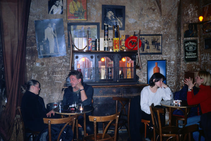 Customers sit in the rustic interior of the Blue Light Jazz Bar in Mala Strana.