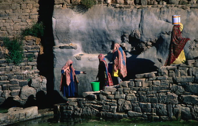 Women collecting water.