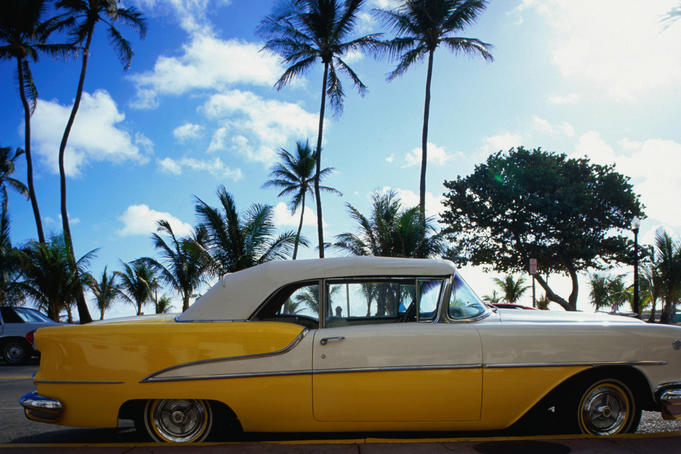 A classic car parked in front of palm trees - Miami, Florida