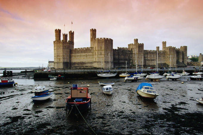 Historic Caernarfon Castle in Gwynedd (Wales). The castle, originally fortified in 1090, was allegedly modelled on the 5th century walls of Constantinople.