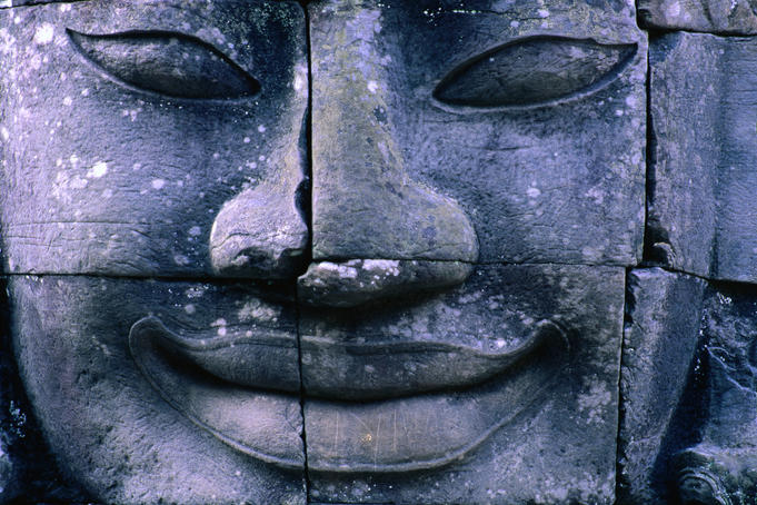 Close up of smiling face of Avalokiteshvara, Bayon, Angkor Thom.