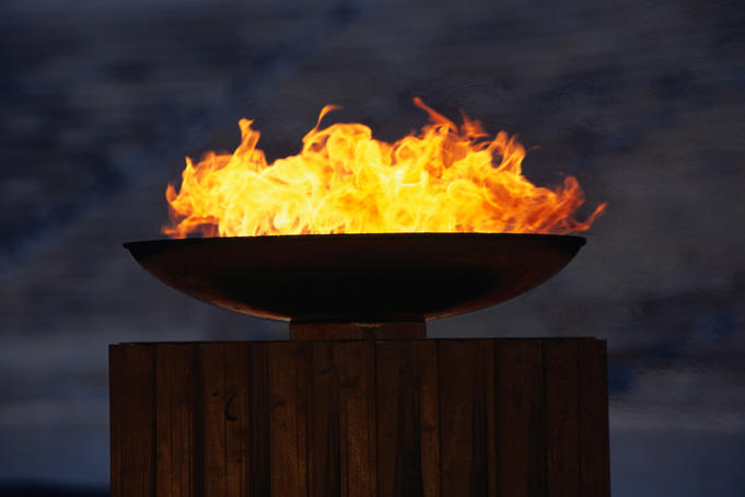 The Olympic flame burning brightly in the reconstructed Stadium of Athens.