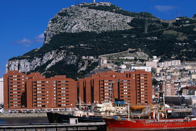 Port and apartment blocks beneath rock of Gibraltar.