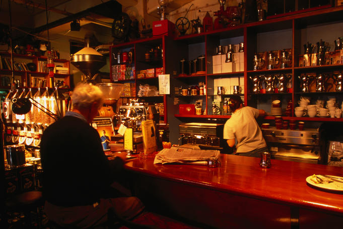 A customer at the bar of Cafe L'Affare.