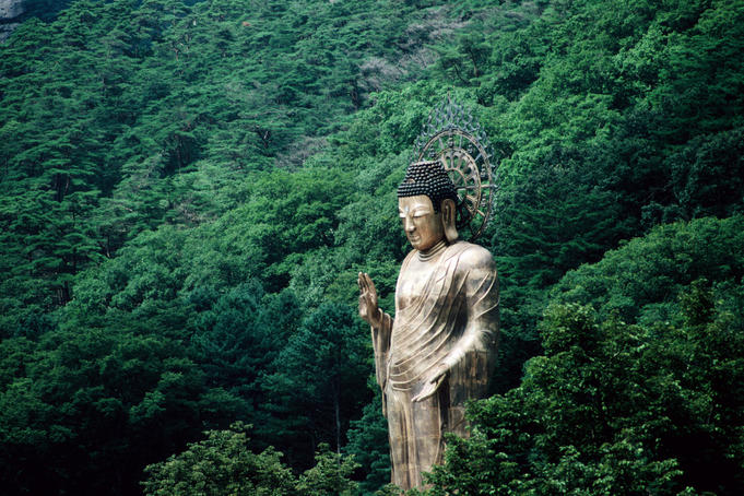 The giant 33m high brass Buddha statue at Beopjusa(Popchusa) Temple on the side of a hill in Songnisan National Park.