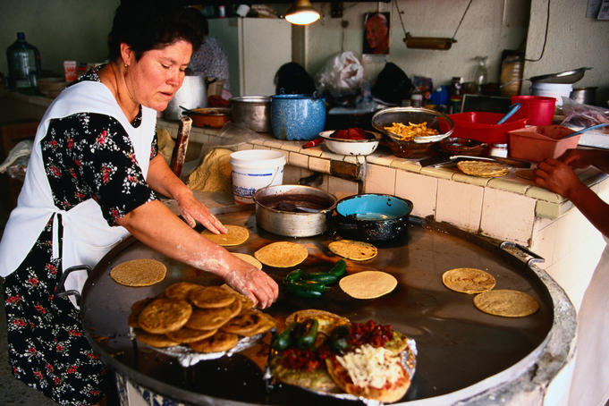 Cooking of sopes (corn dough) tortillas and gorditas (fried maize with refried beans).