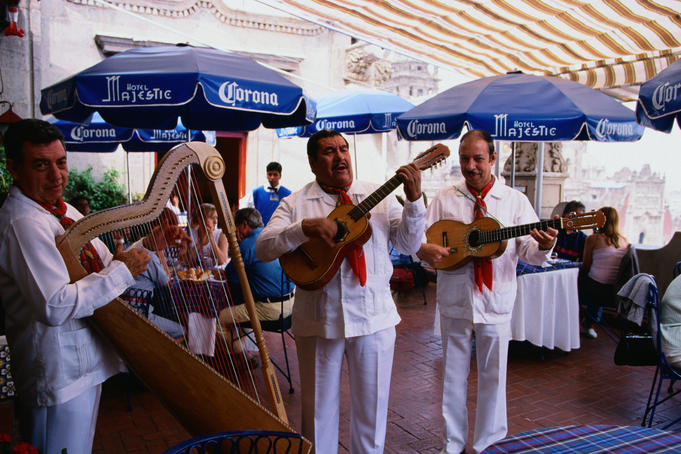 Mariachis of the modern kind catering to the tourist trade - Mexico City